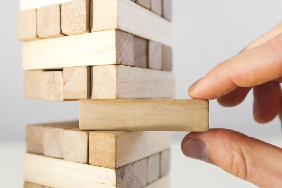 Image Credit | http://www.shutterstock.com/pic-367446221/stock-photo-the-tower-from-wooden-blocks-and-mans-hand-take-one-block.html?src=Nh5ABL_9BqGu4M6nMDCf6g-1-0