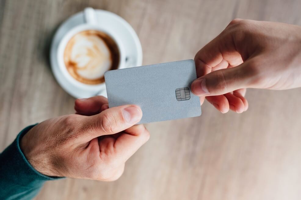 Image Credit | http://www.shutterstock.com/pic-415773415/stock-photo-closeup-of-man-in-cafe-giving-credit-card-to-waiter.html?src=q-0d-DdBMK7t8XjsVWH7PA-1-49